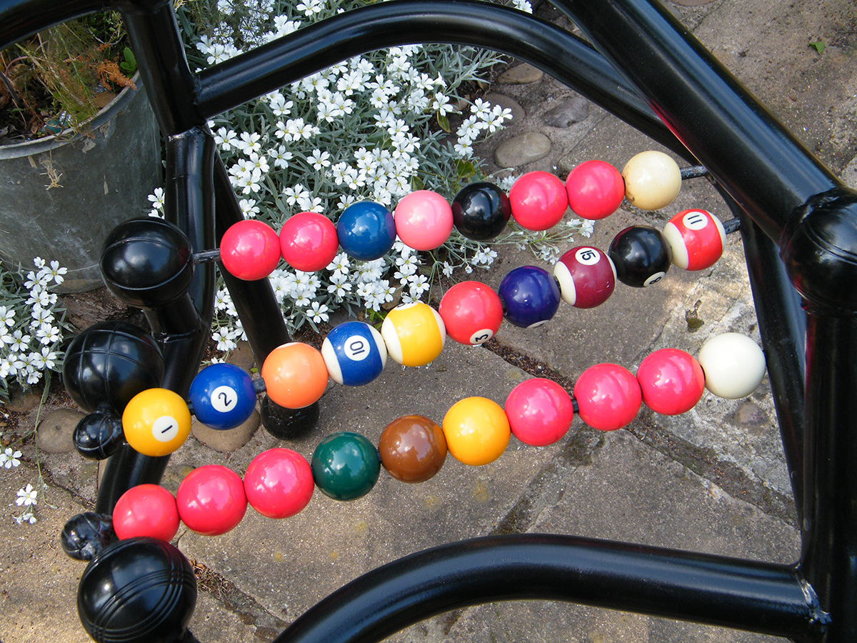 Champions Chair - created from welded steel tubes and rod, snooker and pool balls, steel petanque balls