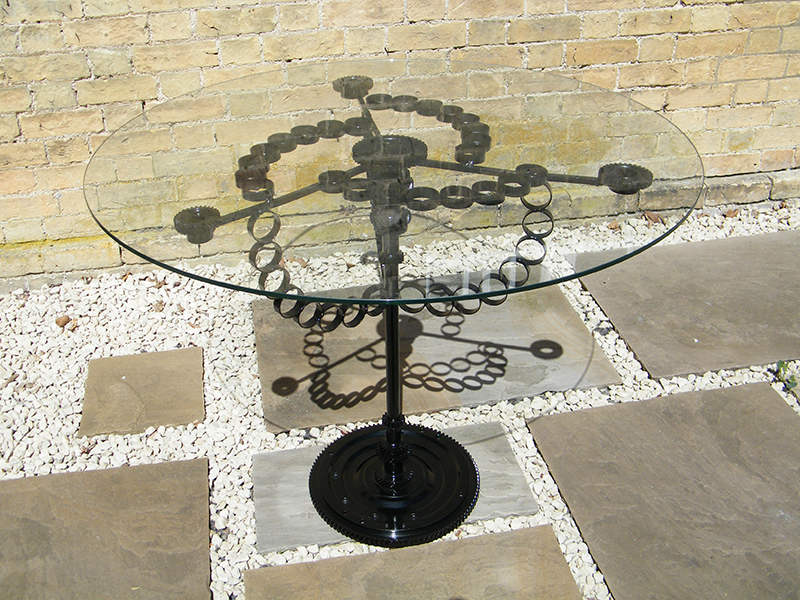 Glass table created from recycled steel and glass
