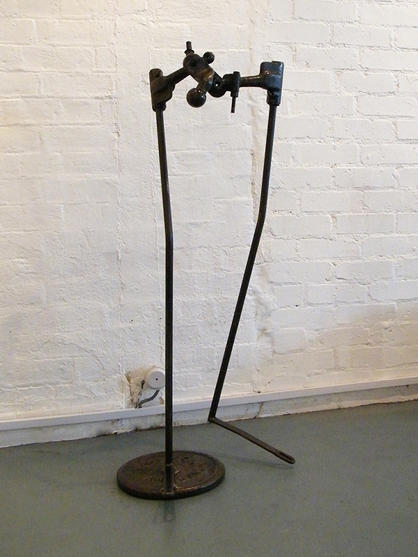Body Sculpture - metal sculpture constructed from found objects from a plough, car parts and a weight