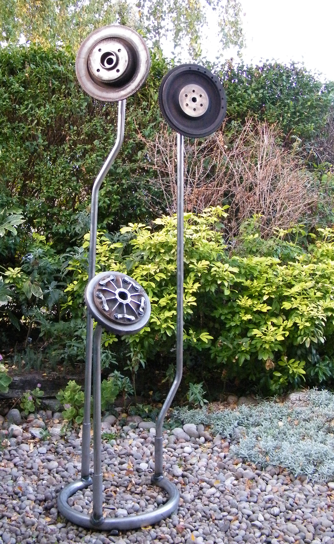 Welded metal sculpture - created from found objects, car parts and metal tubing