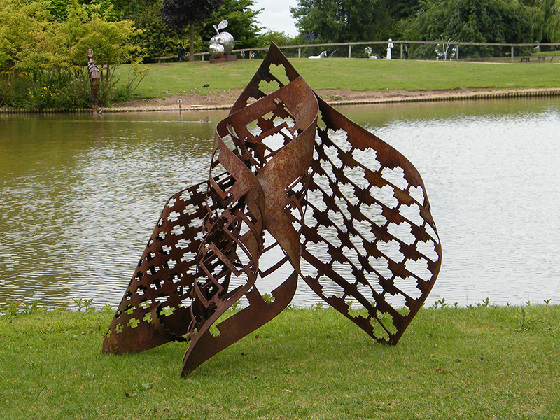 Trinity is metal sculpture created from cnc punched then hand-rolled steel
